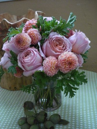 a sweet small arrangement of lush garden roses and local dahlias accented with lemon scented...