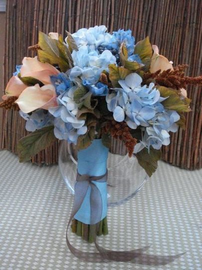"an unusual combination of pale blue hydrangea, ""hot biscuit"" amaranthus, mozart mini callas, and..."