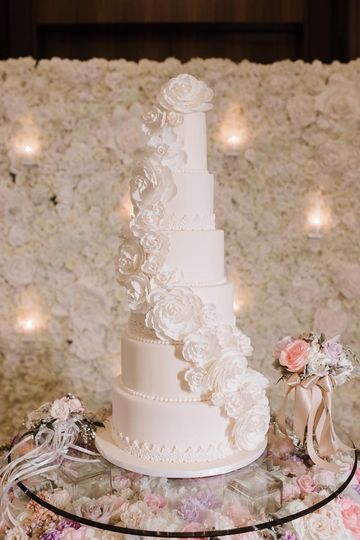 Tall wedding cake with peonies