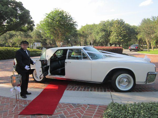 Red carpet, Just Married sign, white bows and a bottle of champagne for your grand exit.