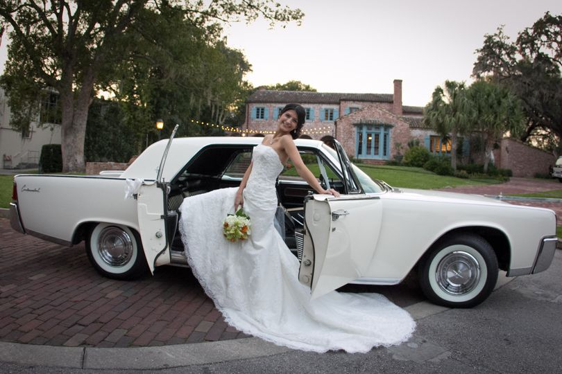 "Unique and Elegant. A beautiful bride with ""Annie"" our beautiful 1961 Lincoln Continental classic..."