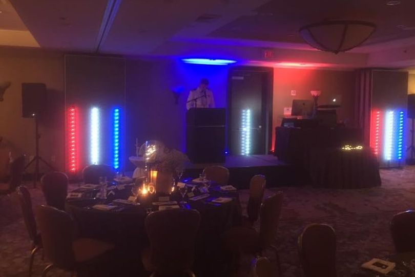 Candlelit tables and reception uplighting