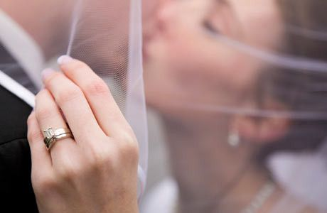 couple kissing with womans ring featured460x300