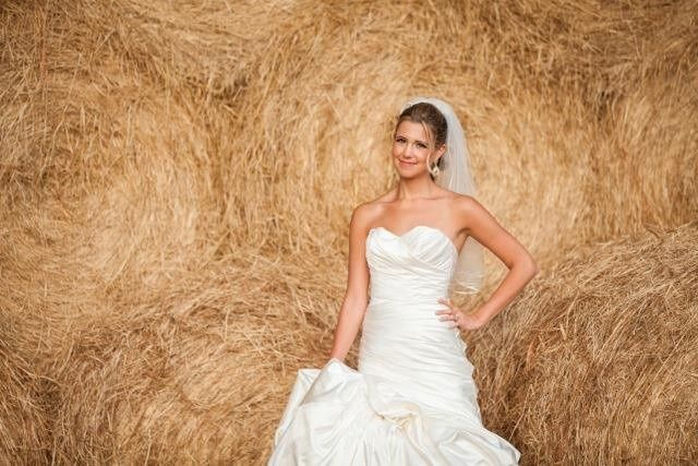 Bride in front of a brown backdrop