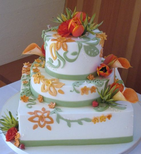 buttercream icing with fondant vine and floer overlay