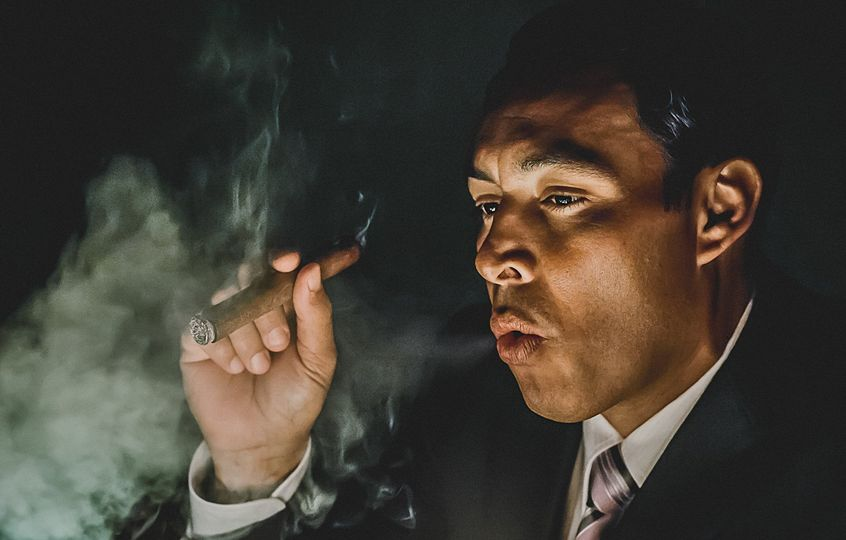Groom smoking cigar