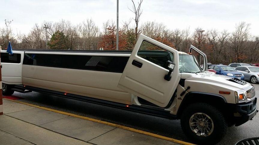 18 - 20 Passenger White Hummer