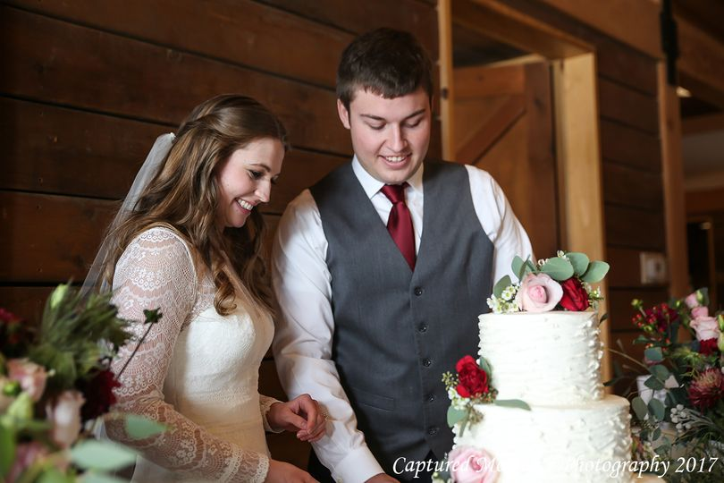 Cutting the wedding cake is the husband and wife's first official act together.