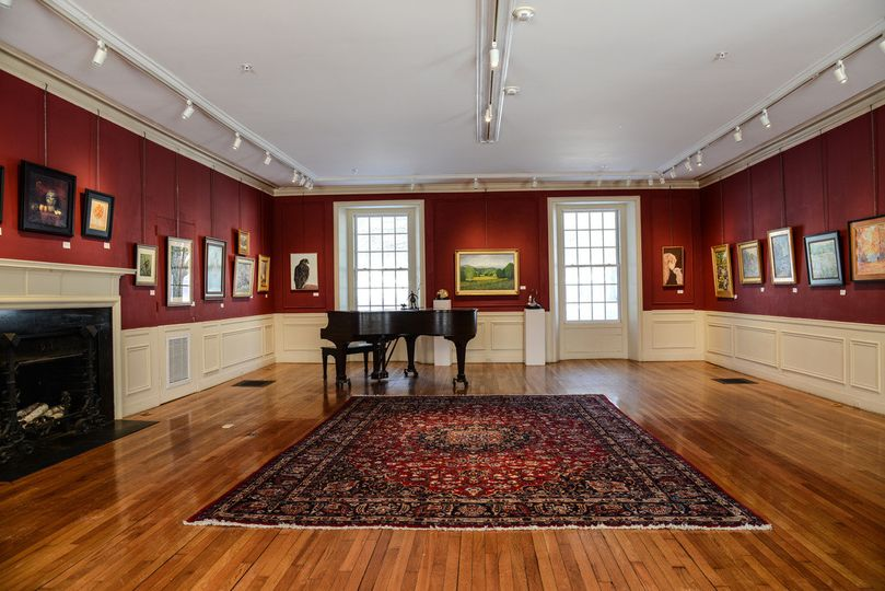 Art gallery with fireplace and piano