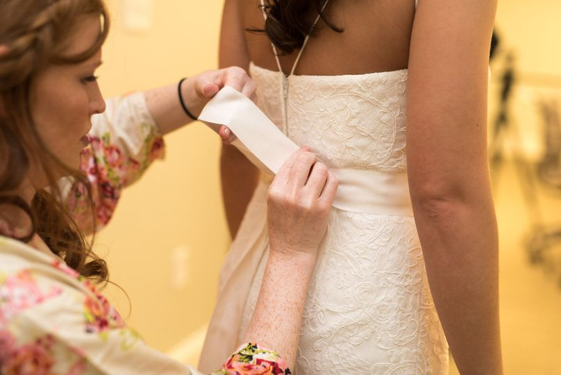 Bride getting her dress altered