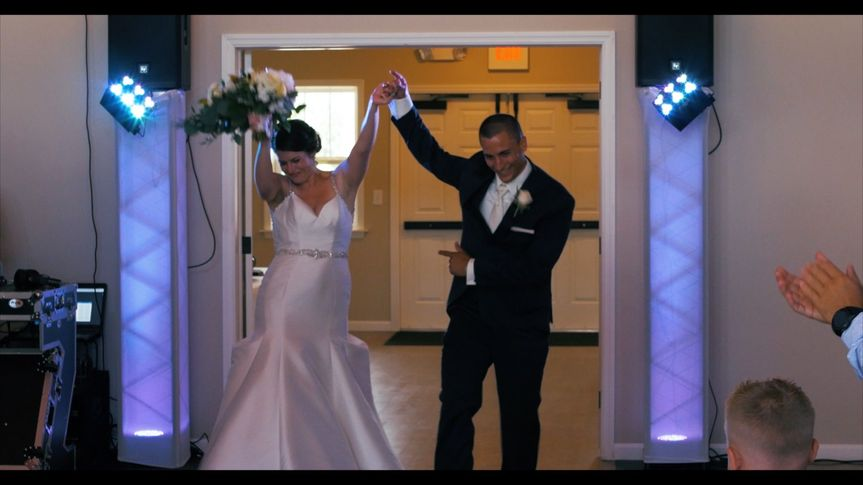 Newlyweds Kelsea and Brett Reed making a memorable entrance to the reception