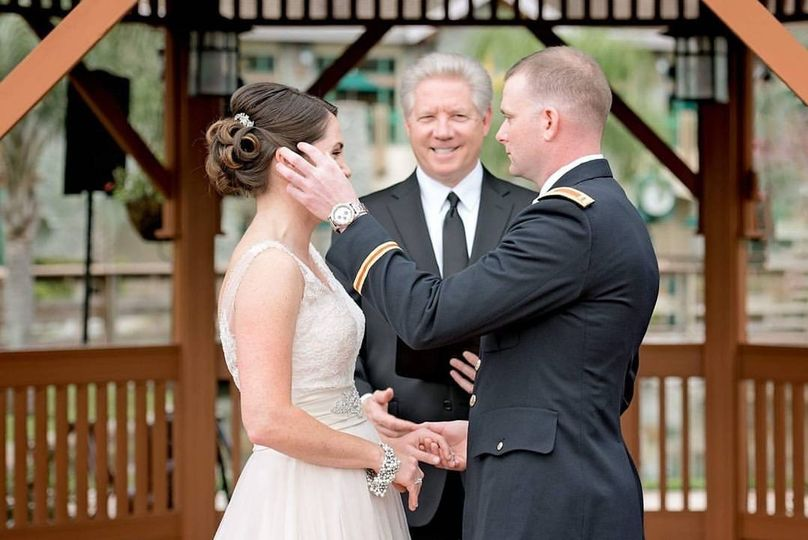 Groom wipes his bride's tears