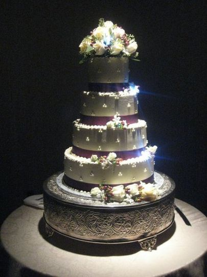 Beautiful cake display accented with lights and flowers.