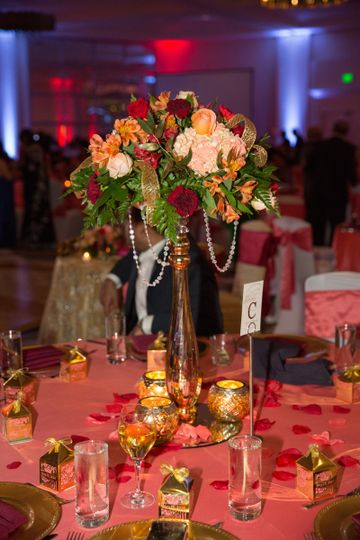 Table setup with floral and candle centerpiece