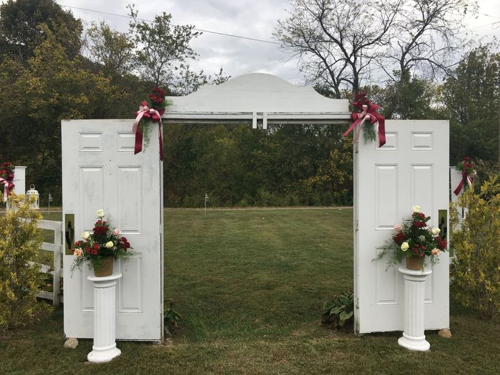 The Entrance for Wedding Party along with Gorgeous Flowers and Accents