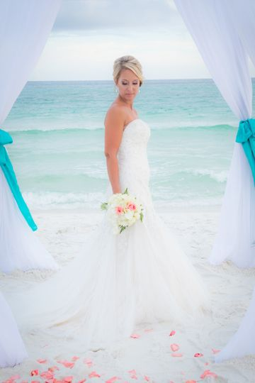 Romantic beach wedding in Ft. Walton Beach Florida - John Beasley Park. Classic bamboo arbor from...