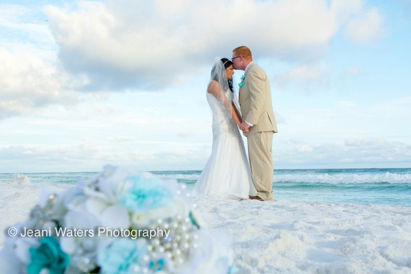 Sweet and romantic ceremony at James Lee Park in Destin Florida.