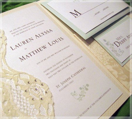 This floral and lace design invitation is printed on a white linen paper stock and mounted on a...