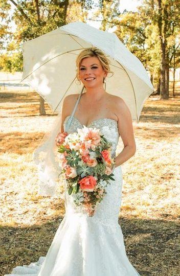 Bride holding a fresh bouquet