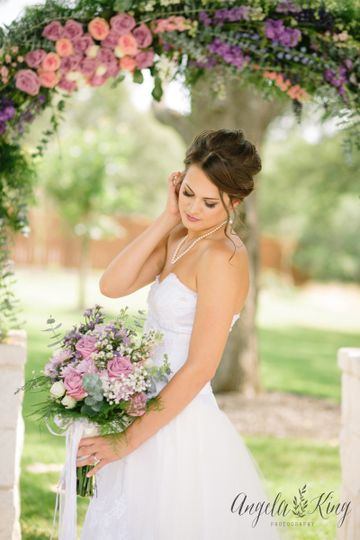 Beautiful bride holding her bouquet