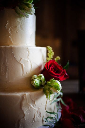 White wedding cake with a rose