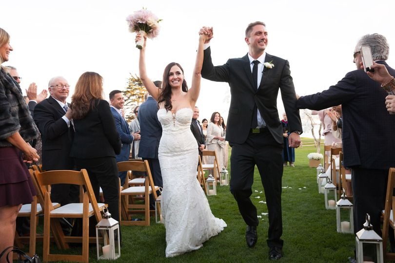 Delighted newlyweds after their wedding ceremony at the Lodge at Pebble Beach.