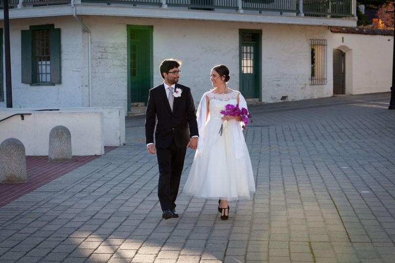 Newlyweds stroll through the historic adobes of monterey, california.