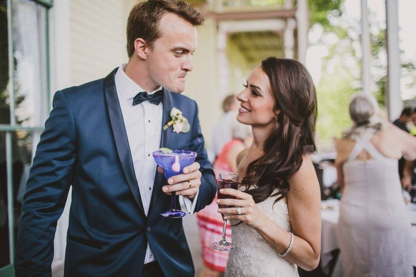 Bride and groom sharing drinks