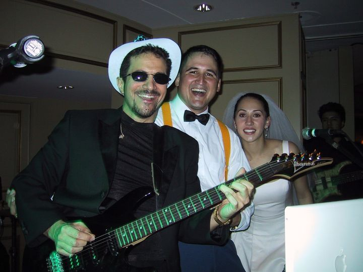 Bride and groom singing with the band