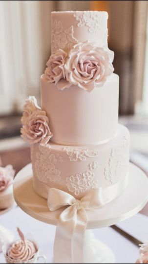 wedding cake pink with roses and satin ribbon
