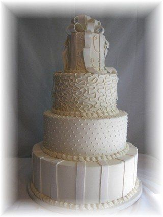 """Ivory Ribbon Cake  18"""", 14"""", 10"""" 6"""" round tiers by 6"""" high  18"""" decorated with fake fondant..."""