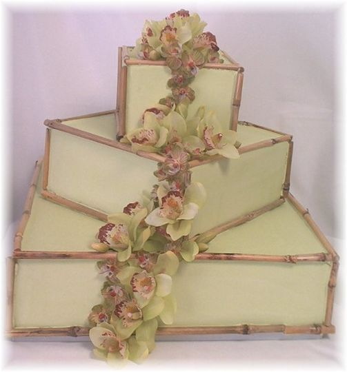 """Bamboo & Orchid Cake  16, 10, 6 - 4""""H offset square tiers light green icing edged with real bamboo..."""