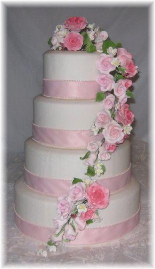 """Pink Ribbon & Pink Gum Paste Rose Sprays adorn this 4 tier fake wedding cake. Tier sizes 12"""",10"""",8""""..."""