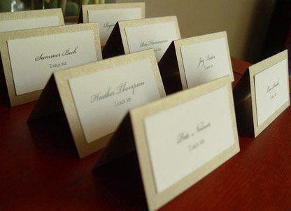 Elegant metallic champagne escort cards.