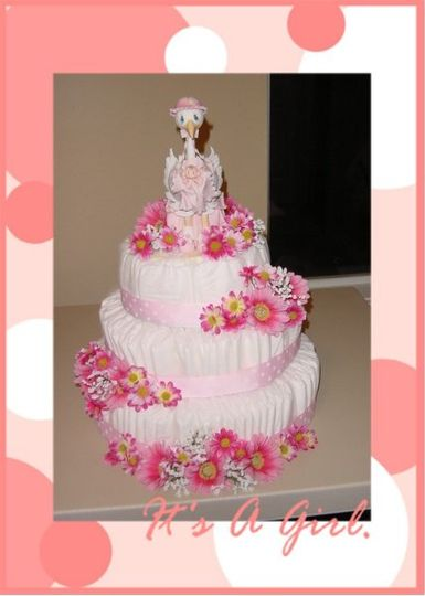 Pink Diaper Cake.  A FUNctional centerpiece with keepsake topper.