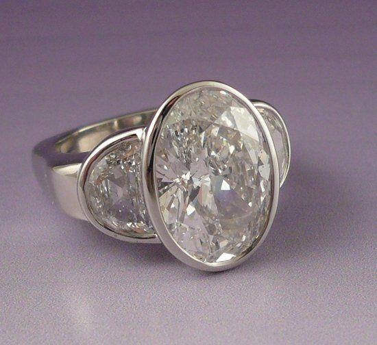 5 carat diamond with half moon sides in platinum.
