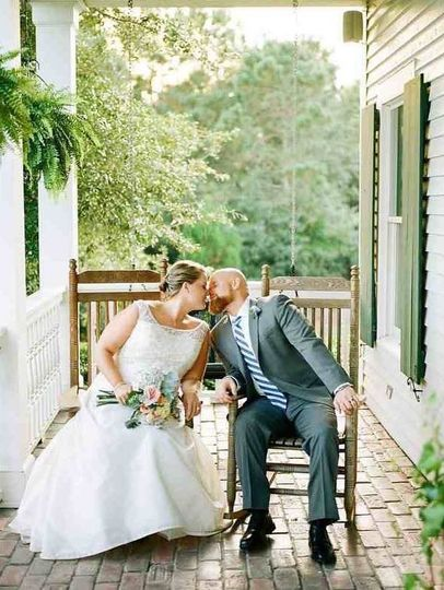 Kissing on the porch