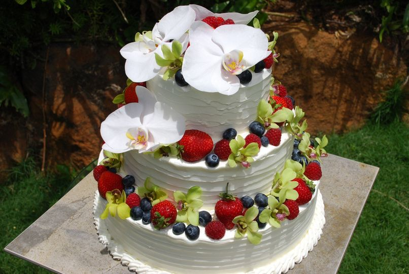 "Wedding Cake 12-9-6"" tier with berries and orchids."