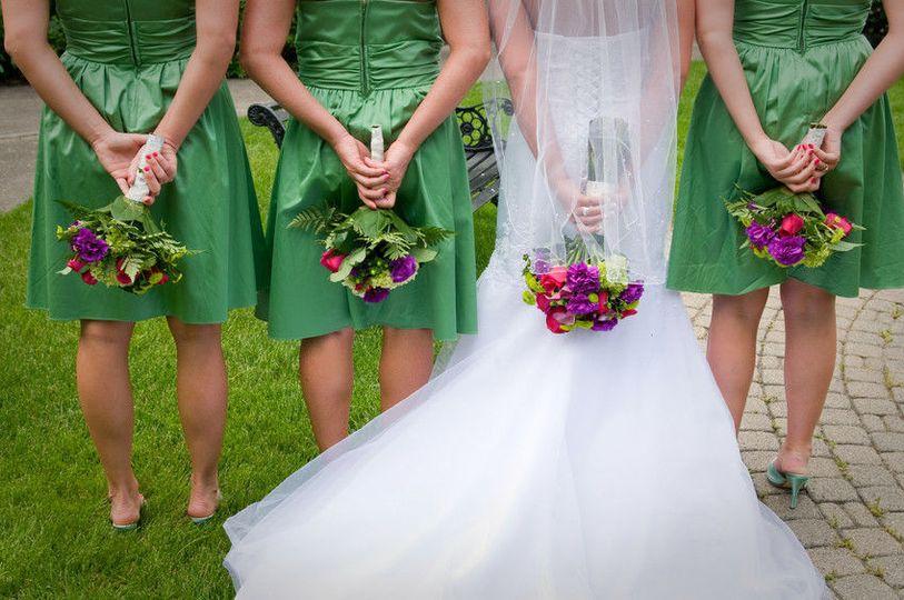 573e7d6a84a3b3b8 1476729017895 bride bridesmaids flowers behind back