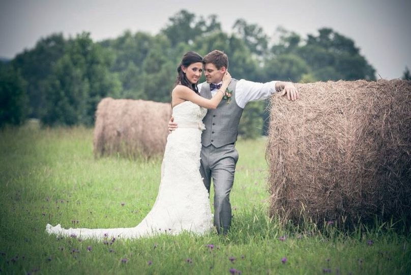 Bride and groom by the hay rolls