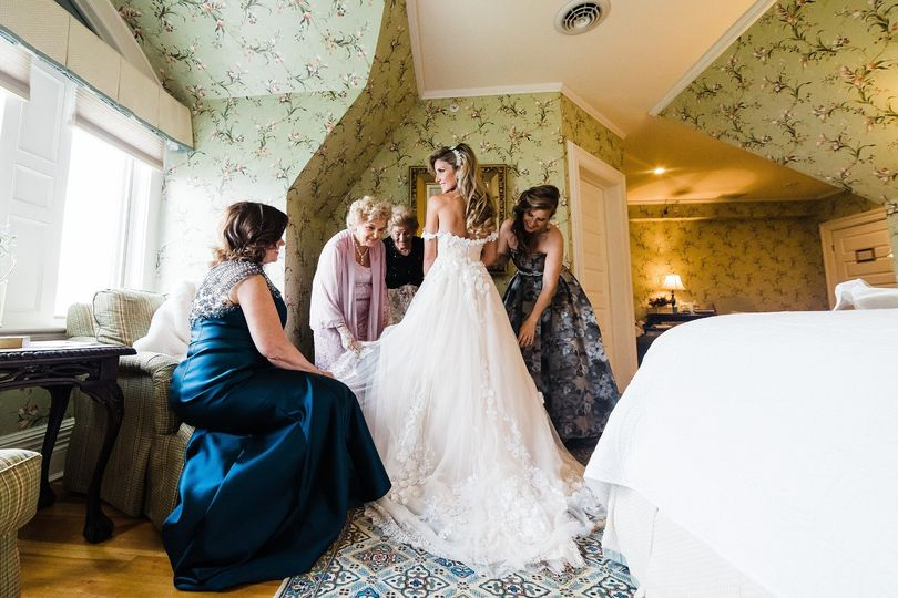 bride getting ready at the inn at earlowest lake george ny 51 909520 1567489951