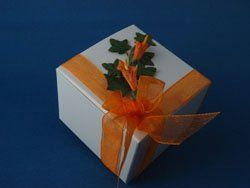 One-Piece Box  This one-piece white box with a tuck in lid comes ready to put on your table. It is...