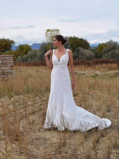 Low back cathedral train wedding gown in crepe with lace belt