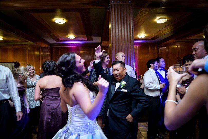 Bride dancing at the Columbus Athenaeum in the Oak Room