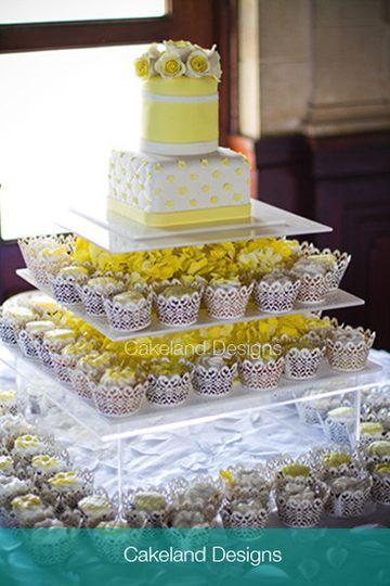 white and yellow cake and cupcake wedding