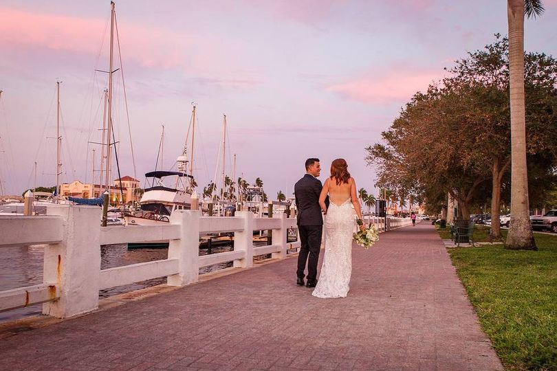 Newlyweds walking by the pier