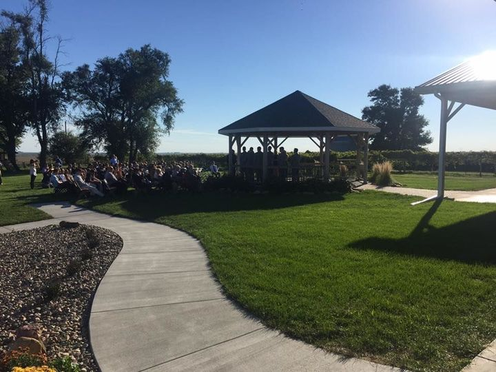 Ceremony setup at gazebo/grass