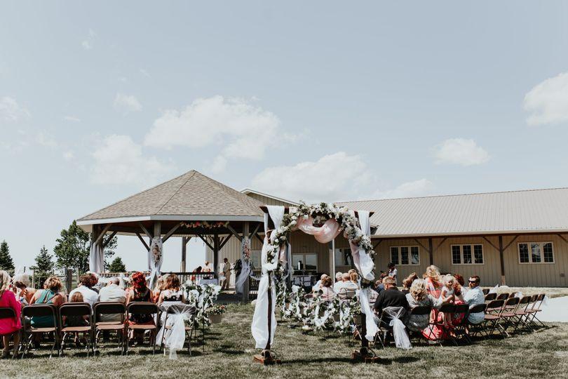 Ceremony setup at gazebo/grass