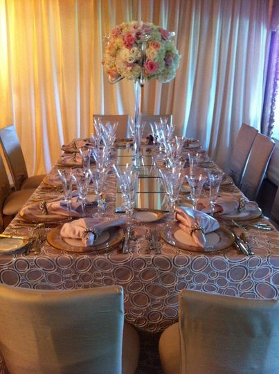 Table setting and raised floral centerpiece