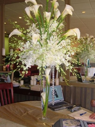 white callas with dendrobiums and crystals on tall